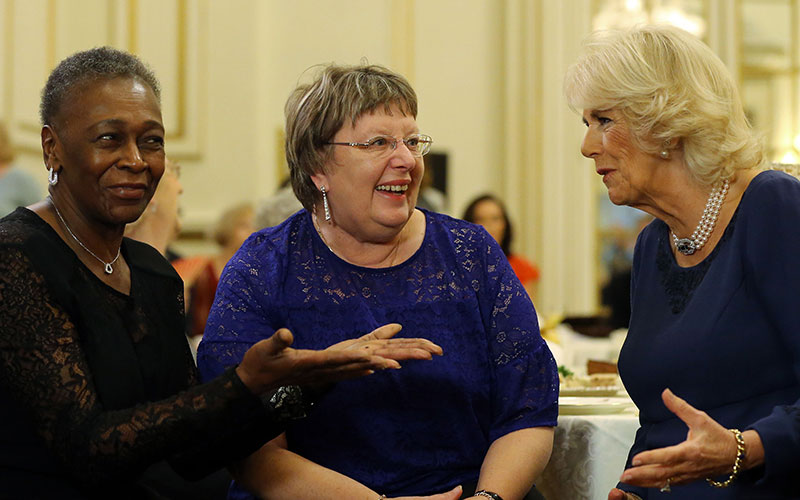 Camilla discusses the tea dance with a U3A member